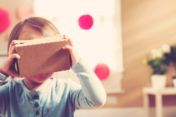 My grandson using a cardboard VR headset.